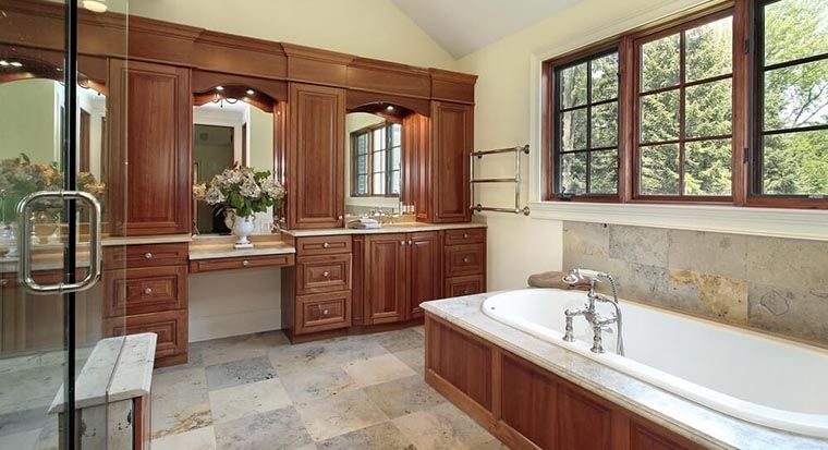 beautiful large bathroom with stone countertops